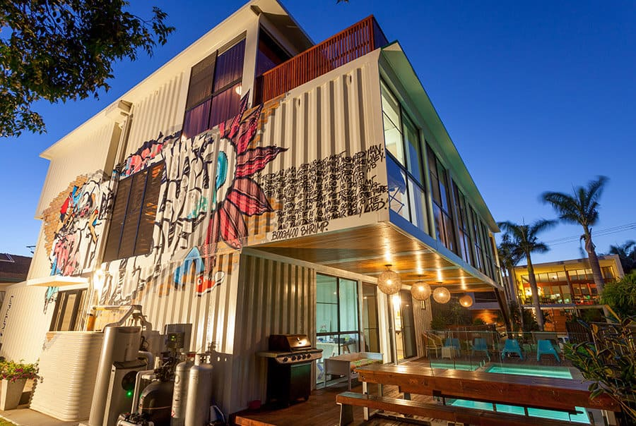 Artsy 3 storey home built from 31 shipping containers for Container home designs australia