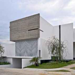 Corner-plot House with Sophisticated Facades