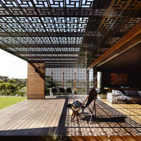 Beach House with Geometric Screens built on Sand Dunes