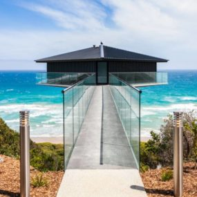 House Perched on Central Column Overlooks Ocean on 3 Sides