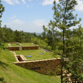 Grass Roofed Home Built into Slope uses Hillside for Cooling