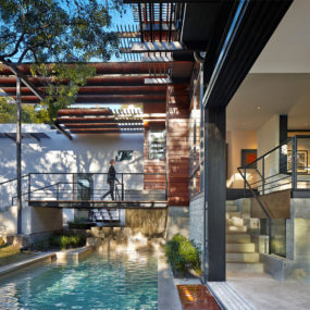 Rancher Morphed into Sustainable 2-Storey House with Bridged Pool