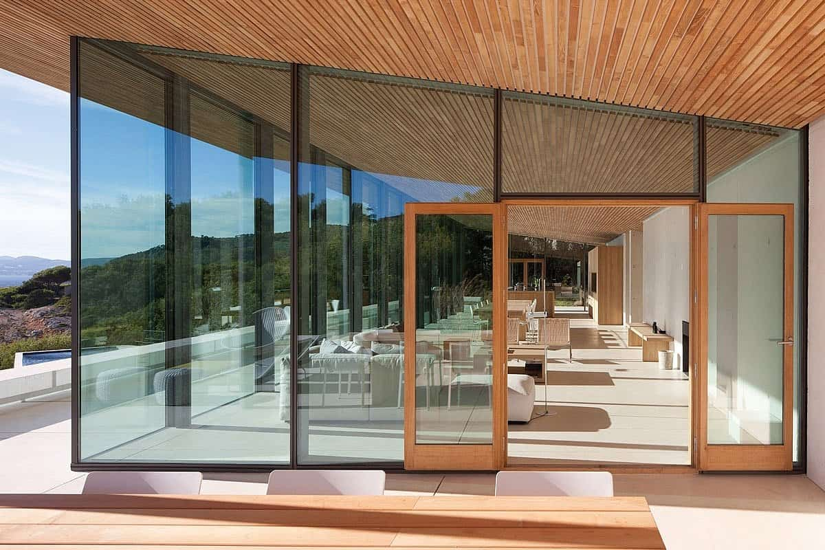 Concrete and Glass Home with Main Level Wood Ceiling ... on Glass House Design Ideas  id=84834