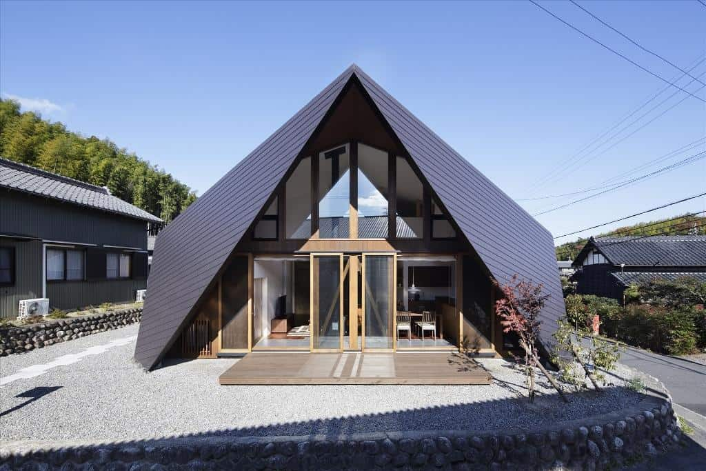 Home Surrounded by Rock Wall and Protected by Folded Roof
