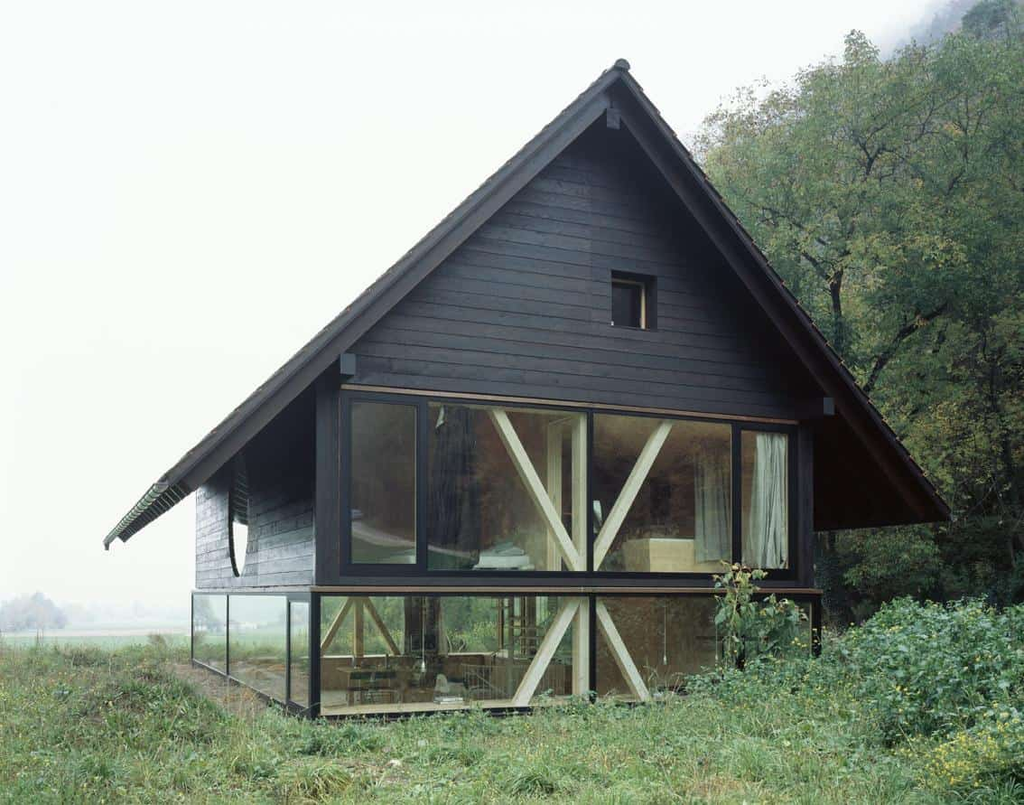 barn home floats round window over lower facade glass 7