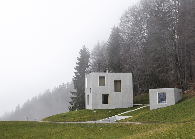 Two concrete cubes comprise main and guest house for Concrete tiny house plans
