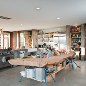 Prefab Concrete Farmhouse: Massive Cypress Slab Table and Salvaged Branch Crystal Chandelier