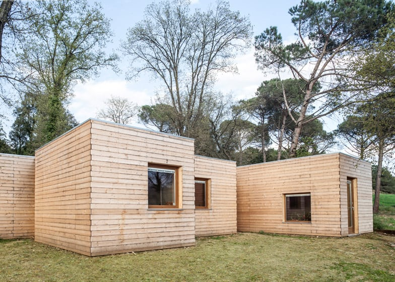 6 prefabricated wood boxes turned into 1 energy efficient for Cheap efficient homes