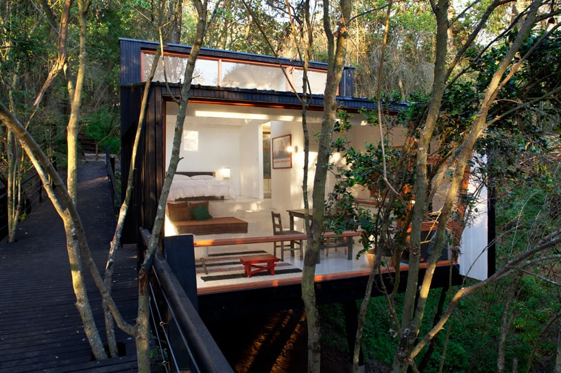 Forest Cabin on Stilts Accessed by Elevated Ramp