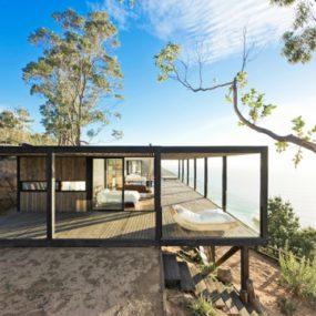 Coastal House on Bluff Designed to Blend into Landscape