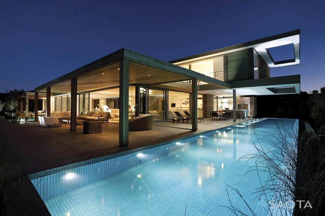 Outdoor home pool  Home Embraces Indoor-Outdoor Lifestyle as it Steps Down Slope