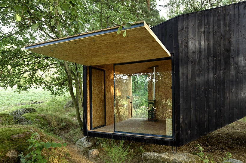 Cute forest cabin supported by a boulder for Building a permanent tiny house
