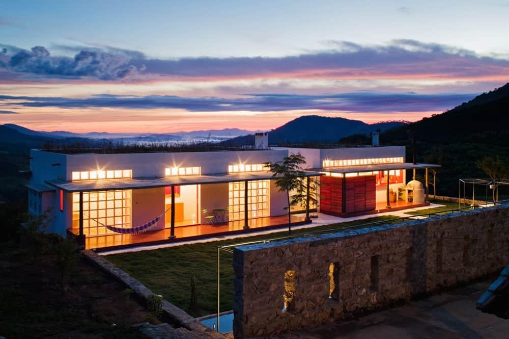 Glass Walkway Links Serine Farmhouse by Brasil Arquitetura