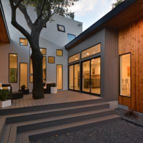 Bold and Modern U-shaped Courtyard House Designed Around Trees