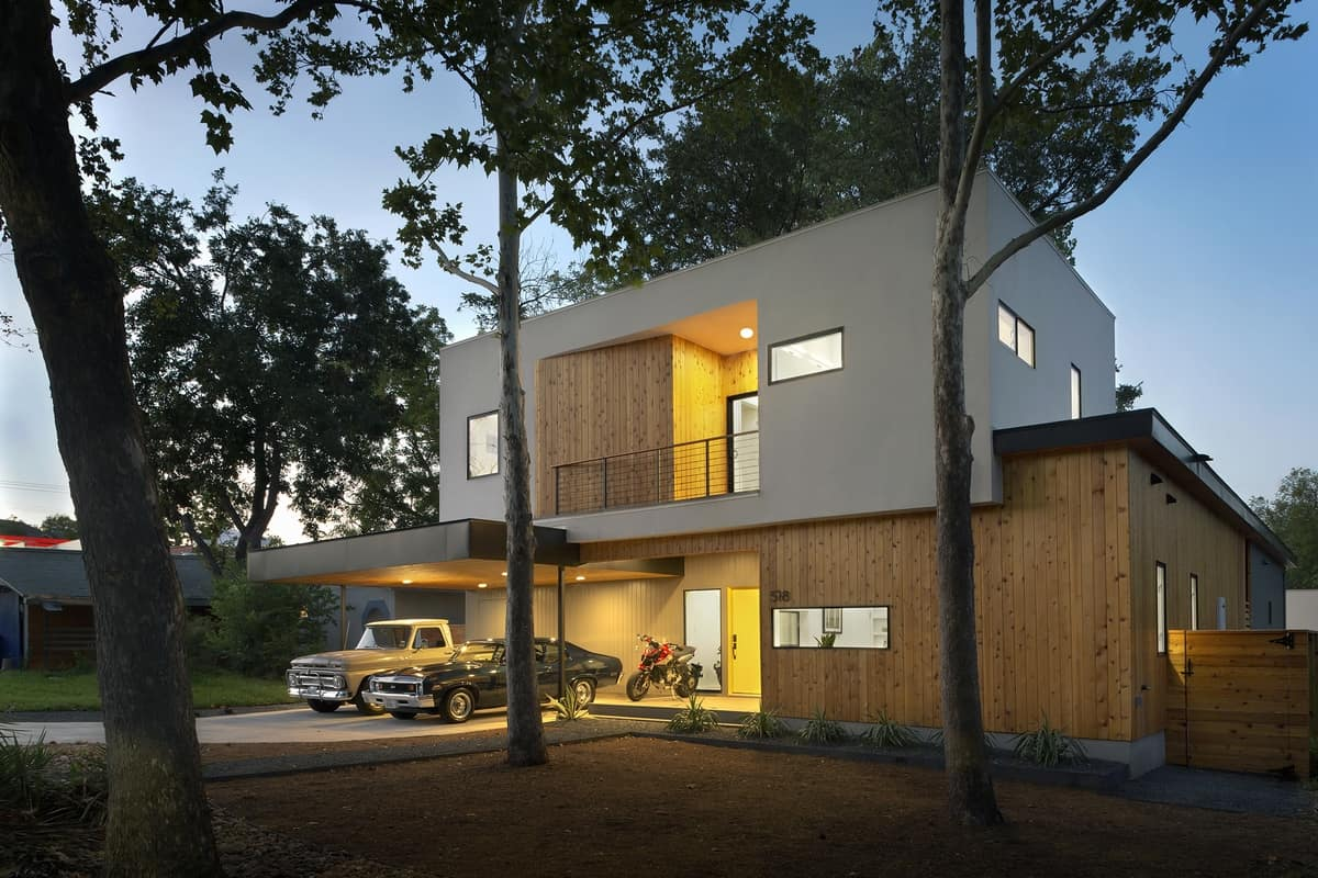 Bold and modern u shaped courtyard house designed around trees
