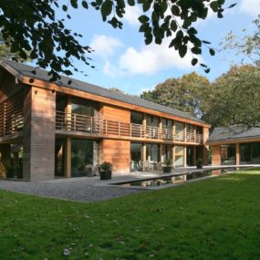 Award Winning Red Cedar Home Resonates with Treed Landscape