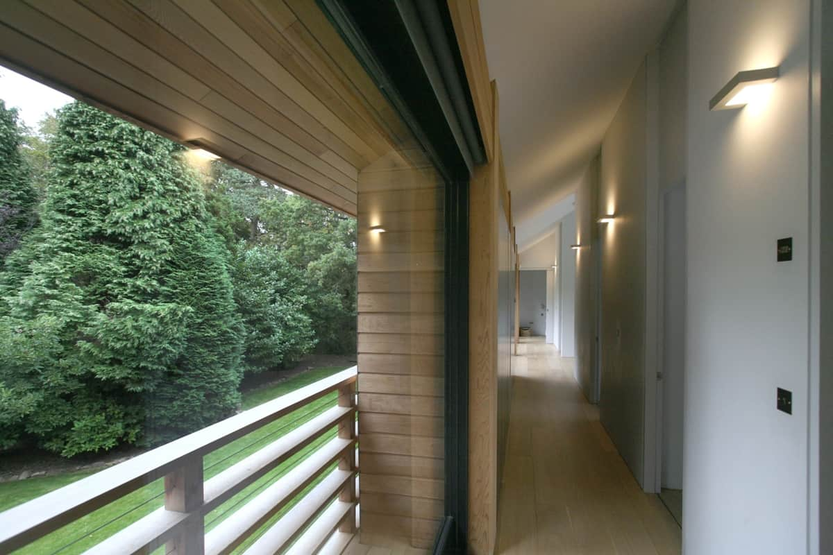 Award winning red cedar home resonates with treed landscape for Award winning house plans 2015