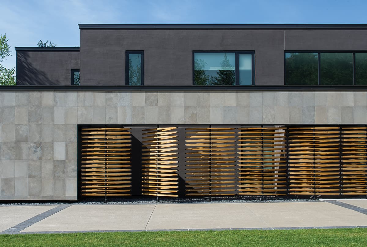 House features wall of operable reclaimed douglas fir screens for Modern house features