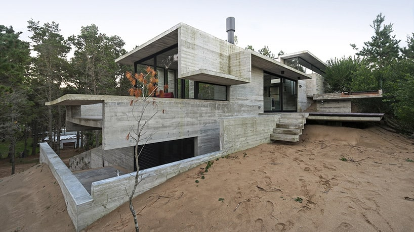 Raw concrete home has everything inside built from concrete for Concrete form homes
