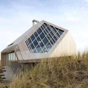 This Absolutely Awesome Turtle Roof Wood Cottage Mimics Dunes and Heats with Bio-fuel