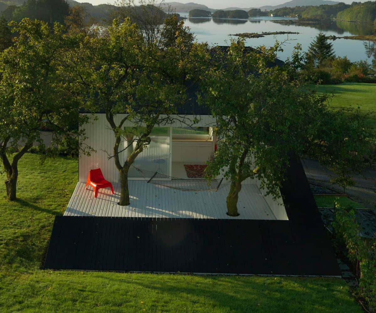 Saunders Architecture Designs Compact Guest Cabin Around Plum Trees