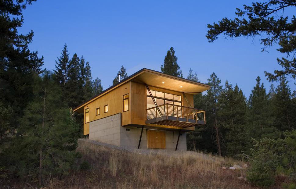 This elevated cabin design was done on a budget plan for Mountain cabin house plans