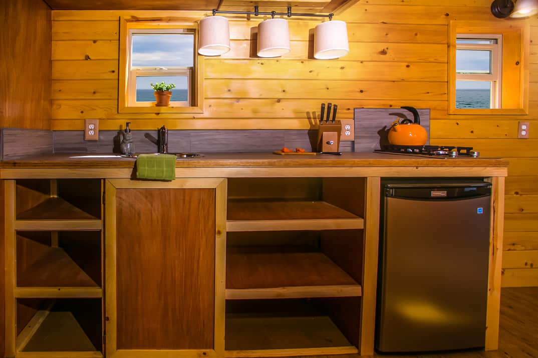Monarch tiny homes will build this prefab trailer for you for Camper kitchen cabinets