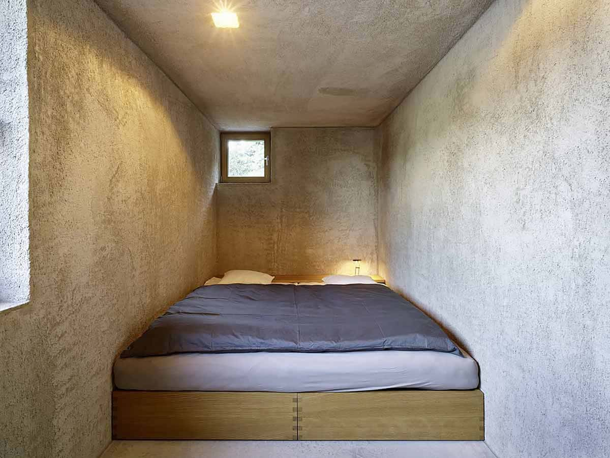 View In Gallery House With Small Cell Like Concrete Bedroom 8.