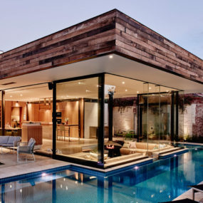 A Sunken Lounge Room Surrounded by a Pool is the Centerpiece of this Home Renovation