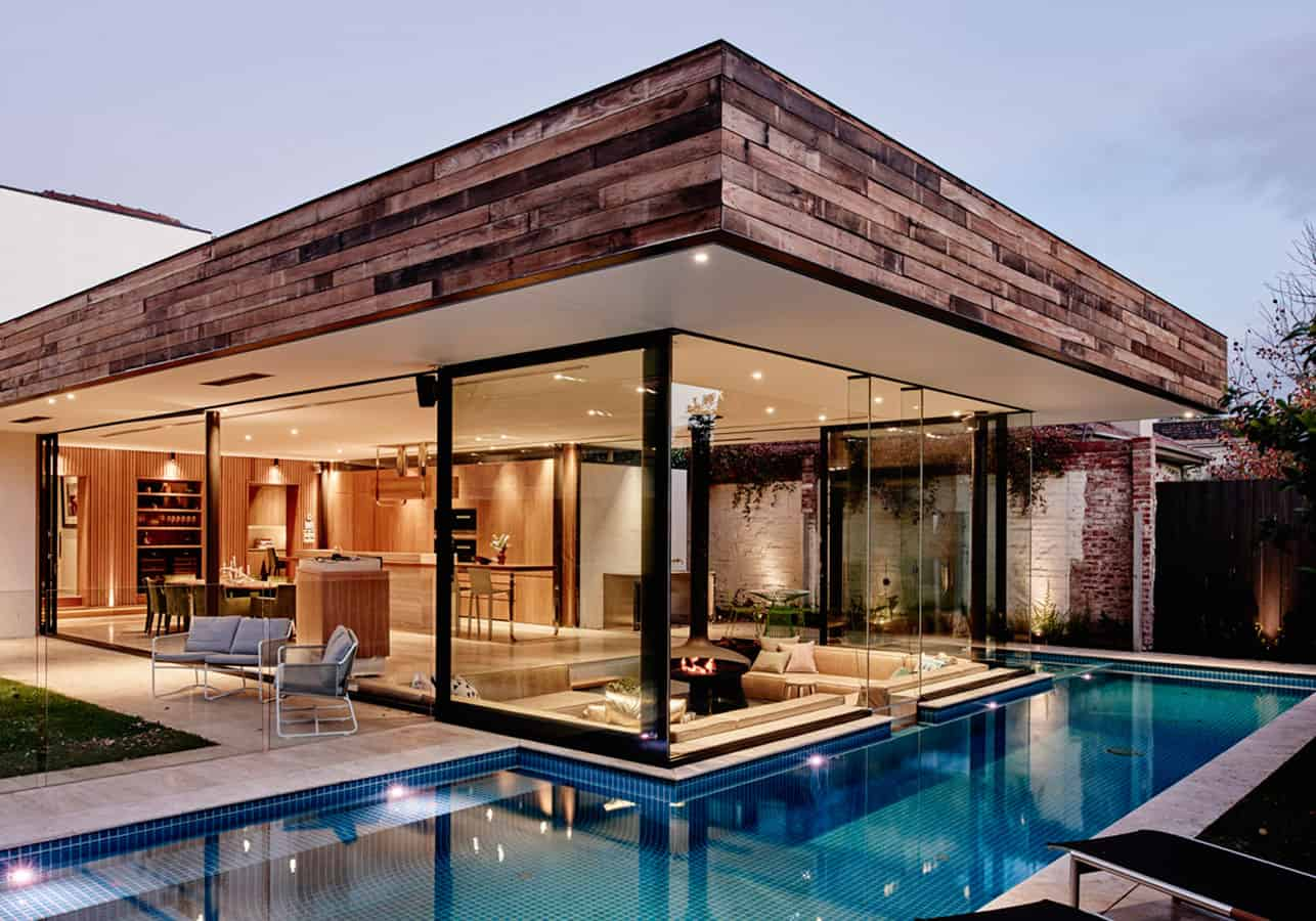 A sunken lounge room surrounded by a pool is the for Small glass house plans