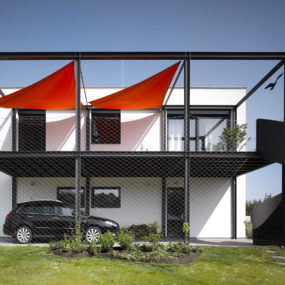 House for Racing Driver Features Main Floor Car Shop