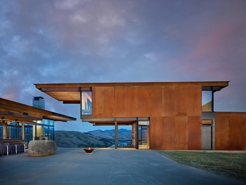 Mountain Glass And Steel Home Designed Around Glacial Erratic Rock