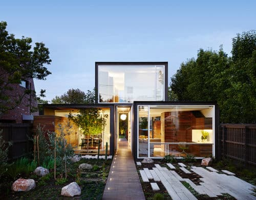 Stacked Volumes Home with Moving Walls and Raised Pool