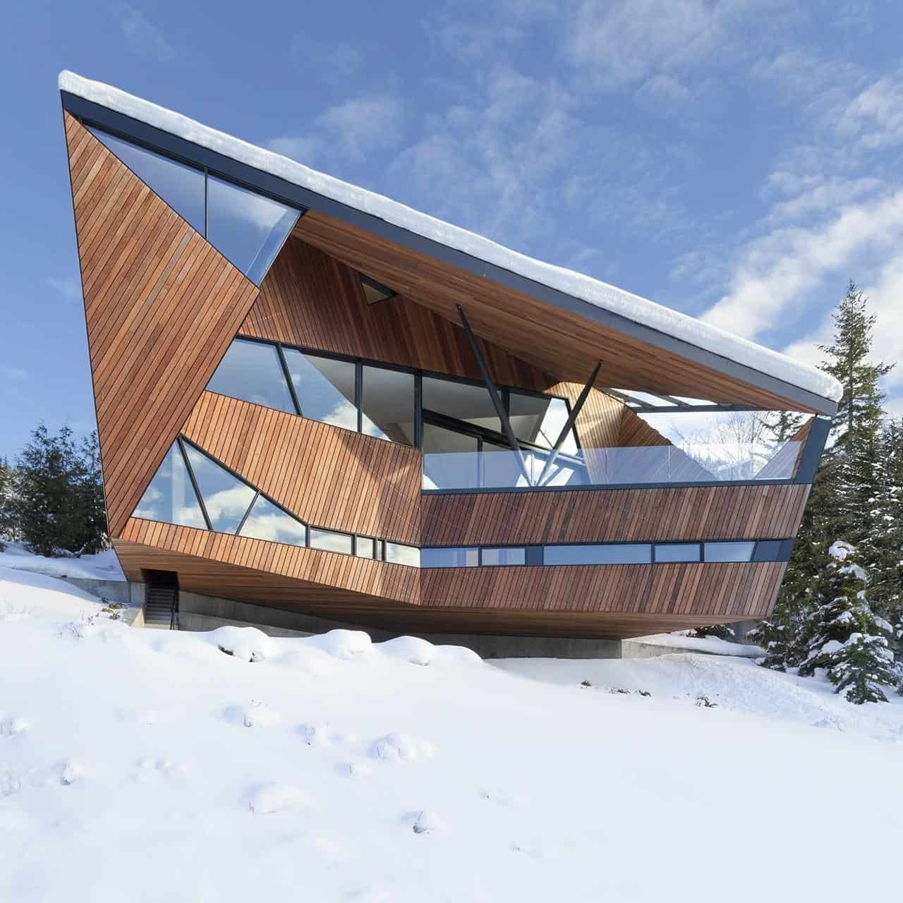 Faceted facade accommodates building codes and snow loads for Building site house