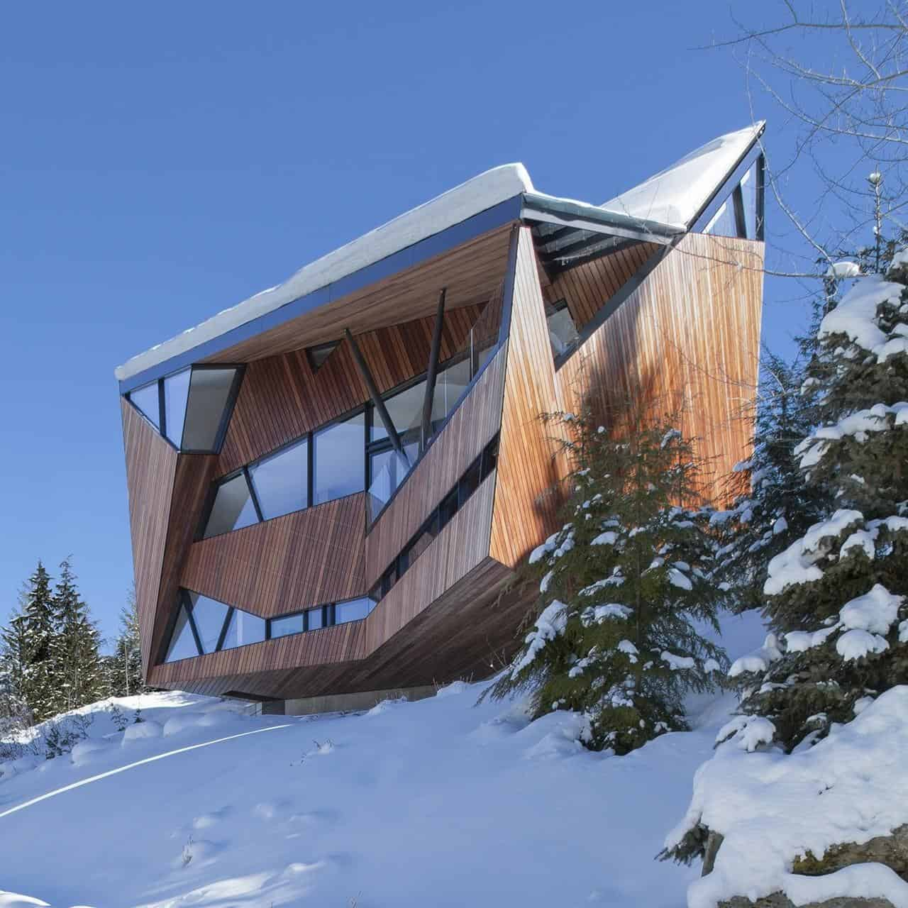 Faceted facade accommodates building codes and snow loads for A frame house characteristics