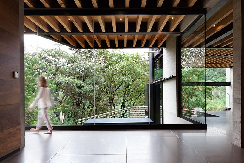 walkway designs for homes. To integrate the interior with surrounding forest and to ensure lots of  natural light Grupo Arquitectura designed home hallways that travel Outdoor Elevated Glass Walkway Connects Two Sections House