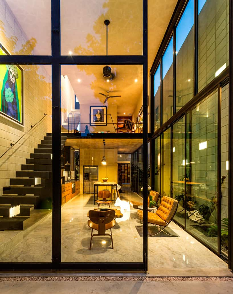 Although The Home Is So Narrow, The Side Glass Wall Positioned Away From  The Concrete Block Wall, Helps To Create The Illusion Of Width To The  Design.