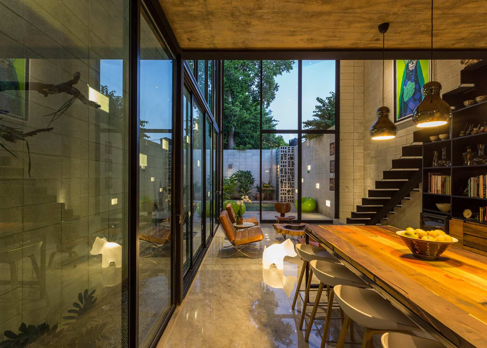 a glass wall on the east of the home acts like an air chimney while at the same time helping draw natural light into the depth of the home - Concrete House 2016