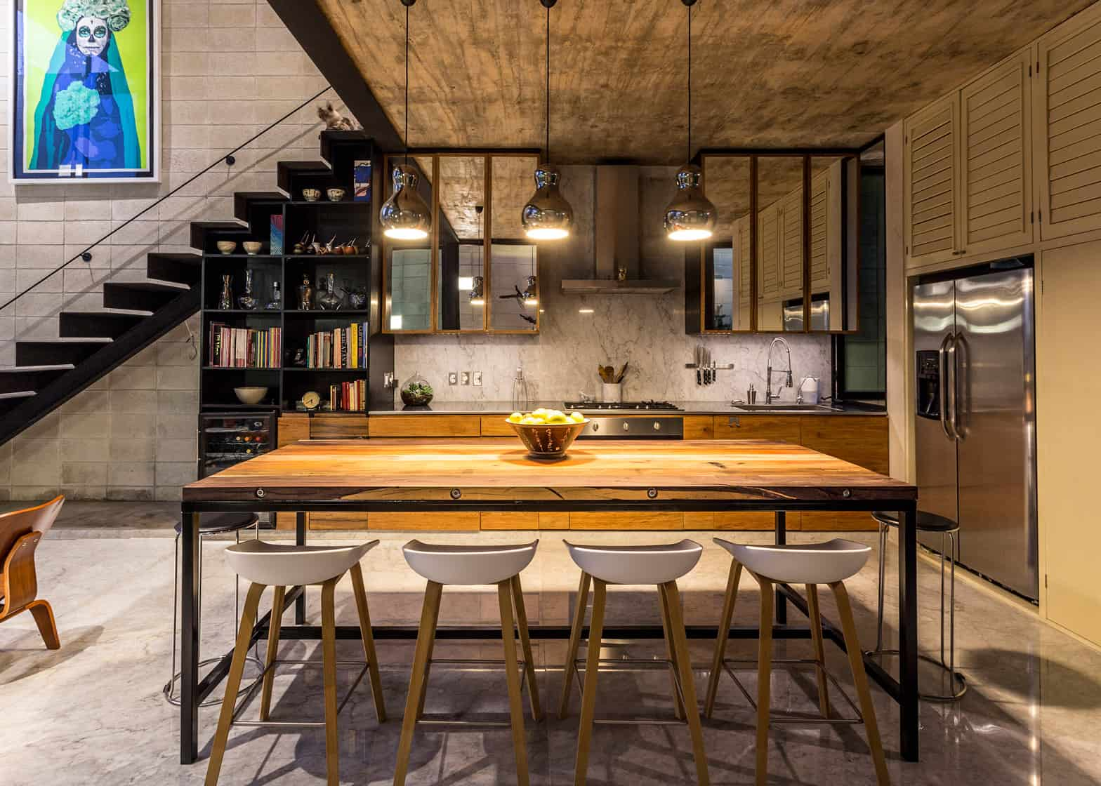 A Single Steel Stairwell On The Side Of Interior Morphs Into Two Rows Kitchen Cabinetry Which Along With Dining And Living Areas Take Up