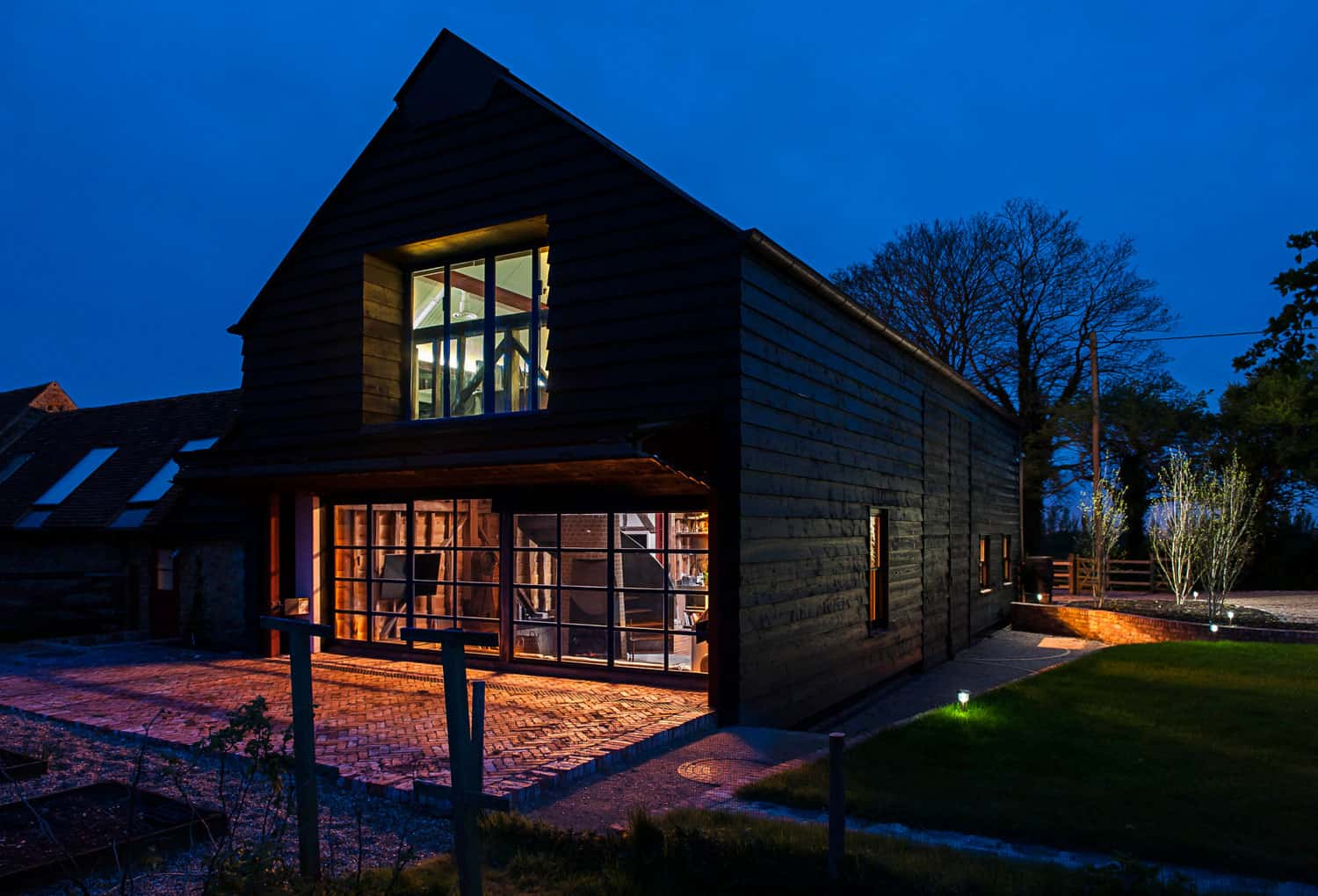 Derelict barn conversion into modern home for Ome images