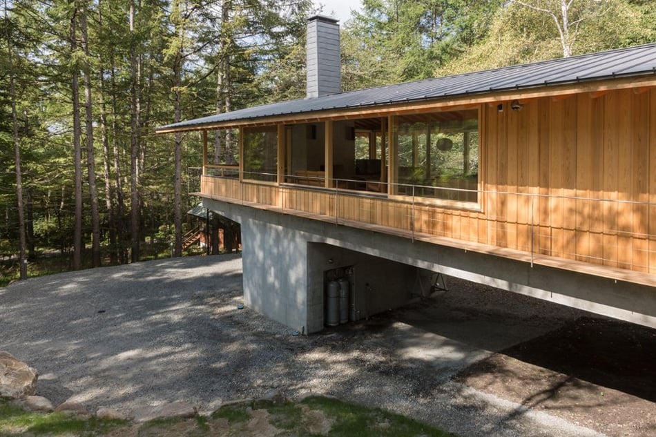 Concrete Plinths Elevate Woodland House Like A Bridge