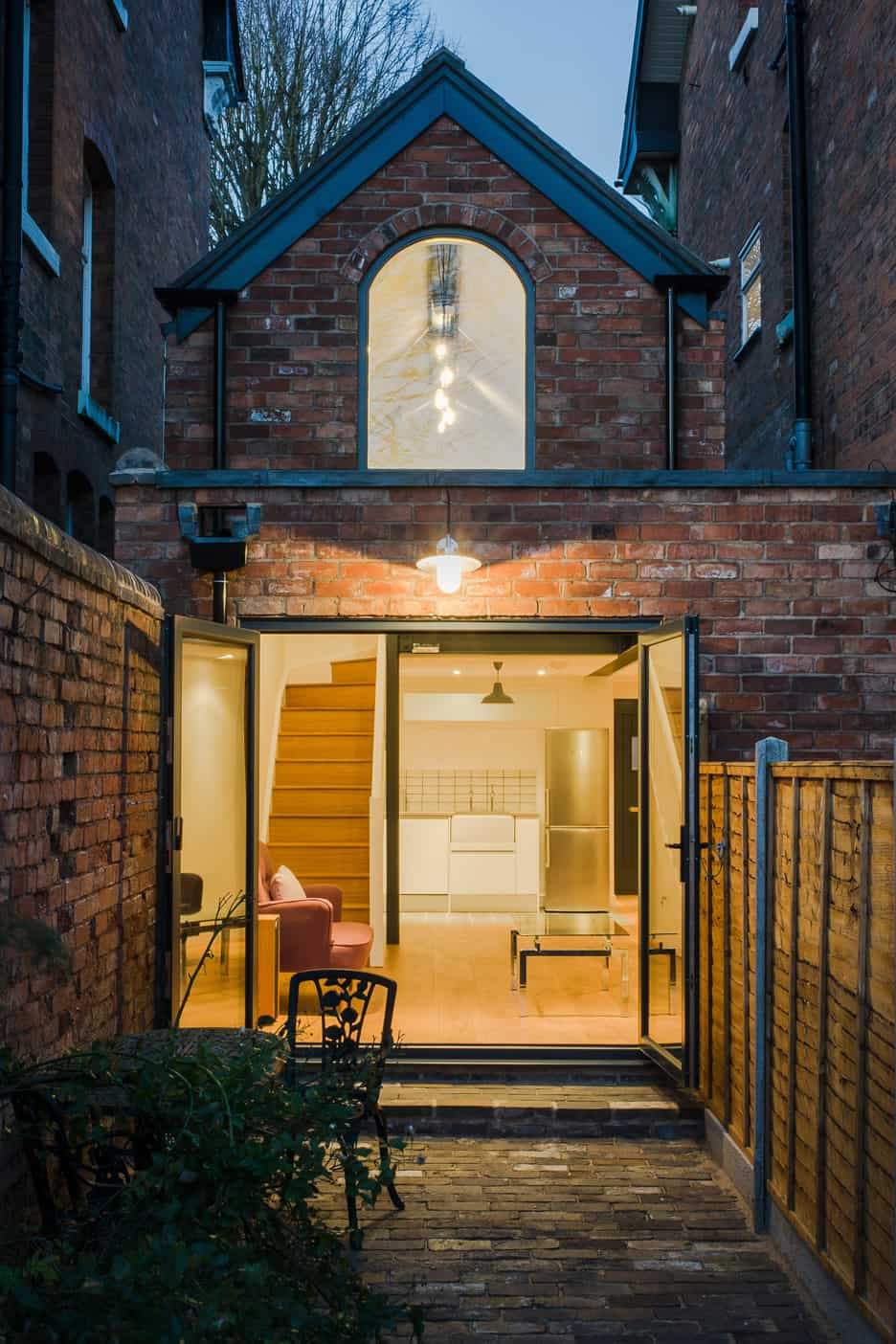 Dilapidated coach house reinvented into small home with loft for Home architectures
