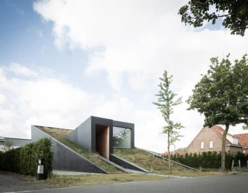 Sloped Green Roof Covers Split Level Home