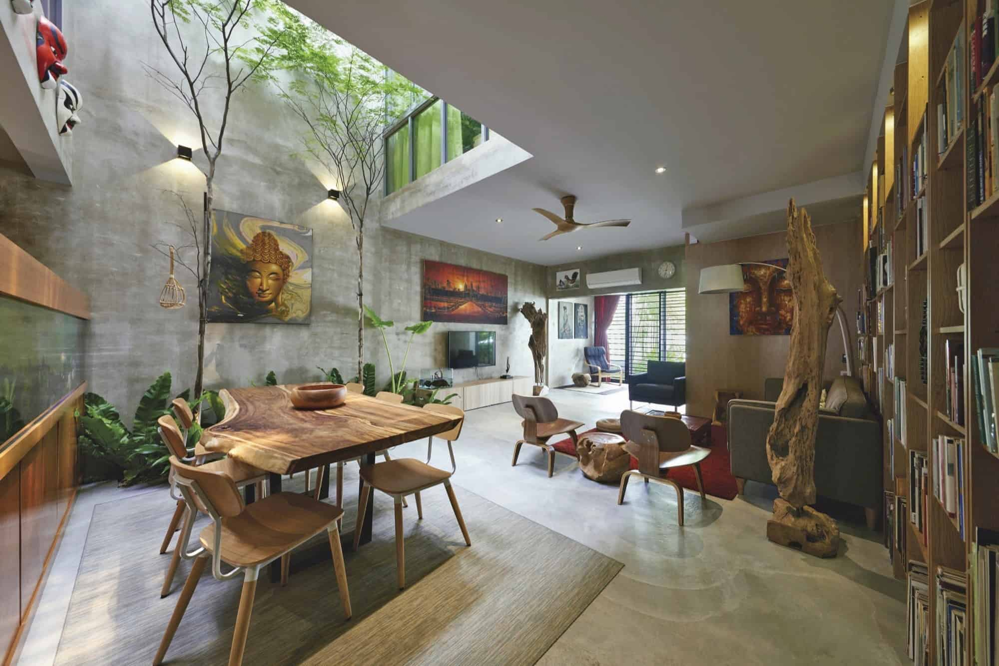 Trees and shrubs create faux courtyard inside house for Modern house with courtyard