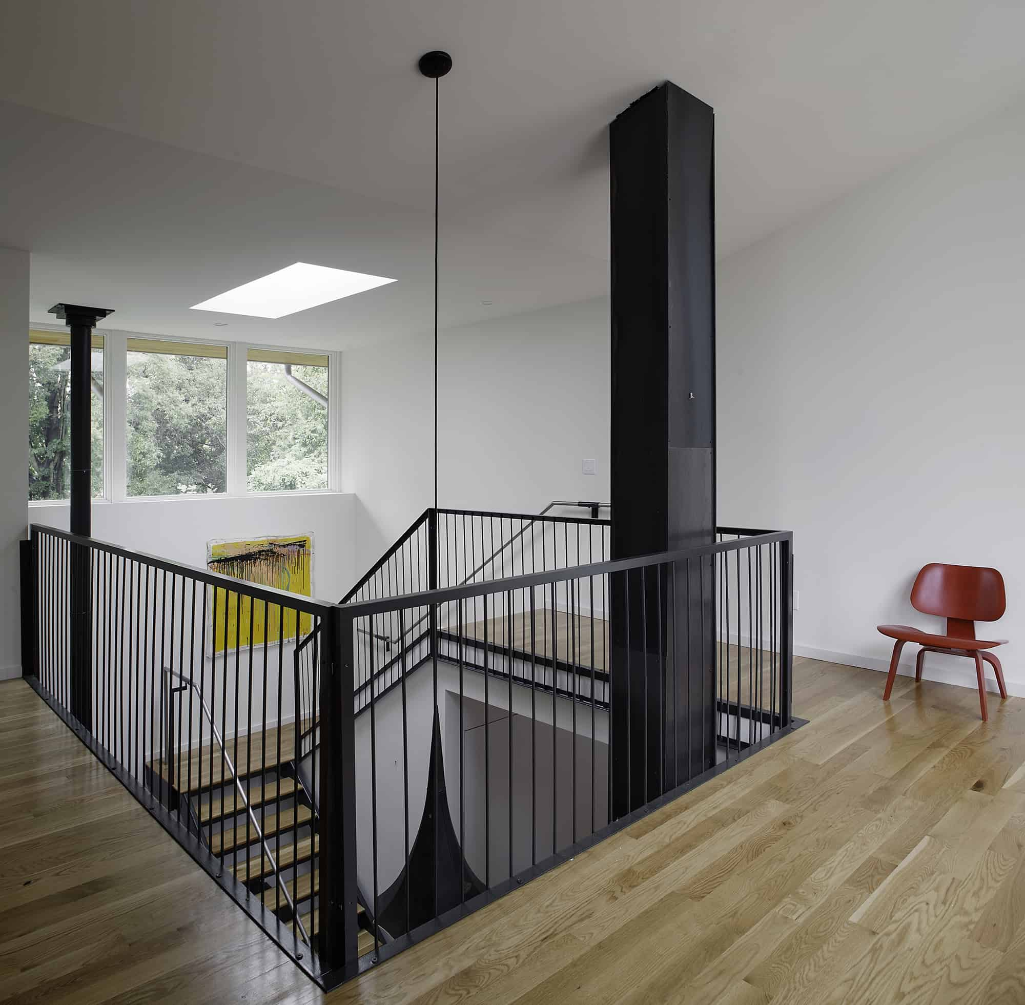 Home with 2 storey kitchen creates drama at mezzanine level for Architecture mezzanine