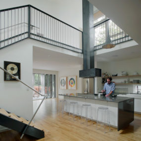 Home with 2-storey Kitchen creates Drama at Mezzanine Level