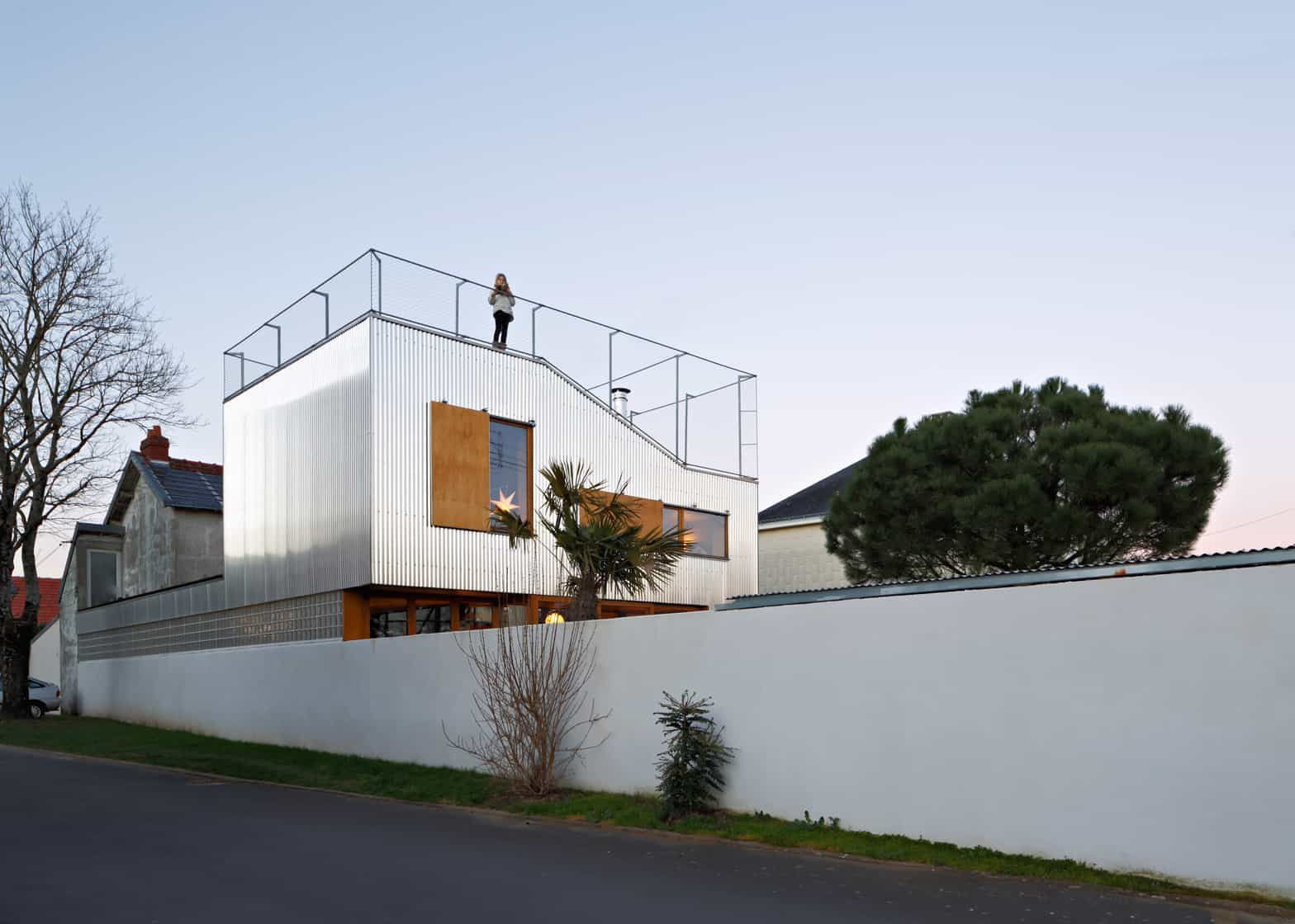 cool french house with corrugated aluminium facade and roof top