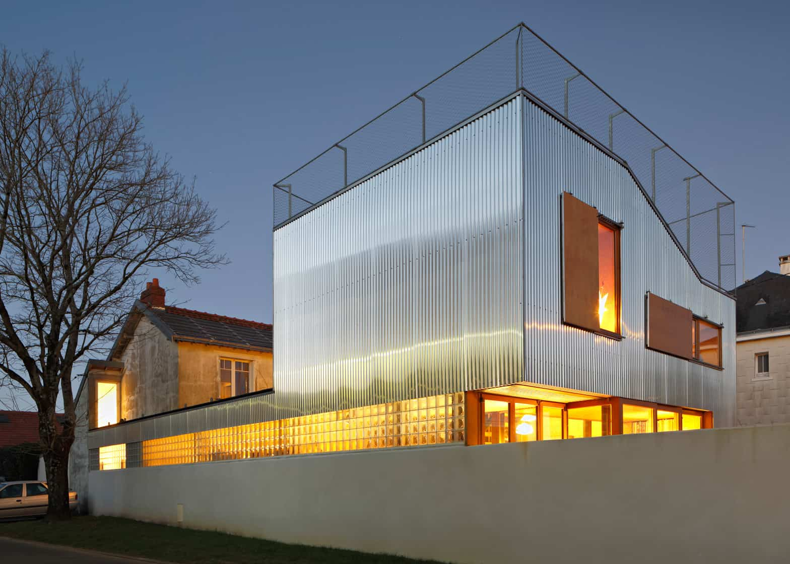 Cool French House With Corrugated Aluminium Facade And Roof Top Terrace on Modern House Facades Design