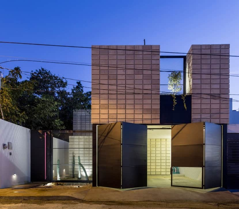 C Shaped Concrete Block Home Wraps Around Swimming Pool