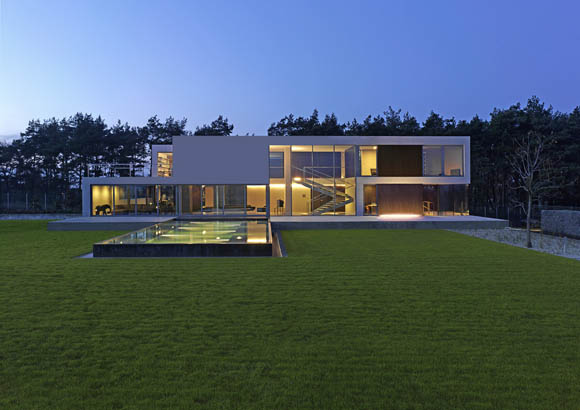 Contemporary cave house by award winning polish architect for Award winning modern house plans